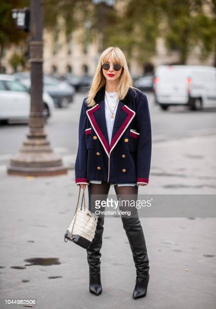 Kerry Peri wearing blazer tights white black Chanel bag is seen outside Chanel during Paris Fashion Week Womenswear Spring/Summer 2019 on October 2...