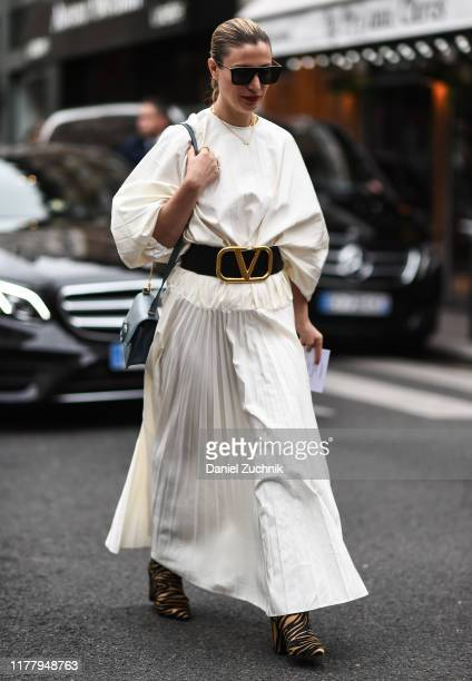 Kerry Pieri is seen wearing a white dress and a Valentino belt outside the Thom Browne show during Paris Fashion Week SS20 on September 29, 2019 in...