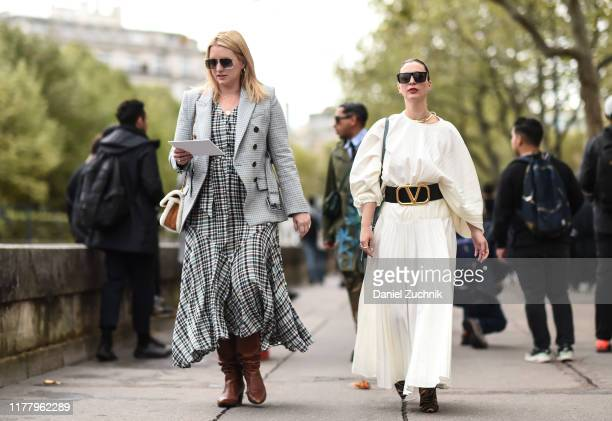 Kerry Pieri is seen wearing a white dress and a Valentino belt outside the Valentino show during Paris Fashion Week SS20 on September 29, 2019 in...