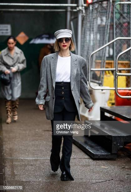 Kerry Pieri is seen wearing baker boy hat, grey blazer during New York Fashion Week Fall / Winter on February 11, 2020 in New York City.