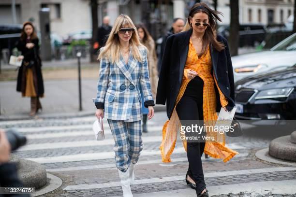 Kerry Pieri is seen wearing plaid suit and Danielle Bernstein wearig orange dress with slit black jacket outside Elie Saab during Paris Fashion Week...