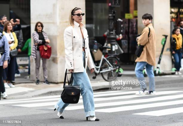 Kerry Pierri is seen wearing a white coat, blue jeans and Chanel bag outside the Giambattista Valli show during Paris Fashion Week SS20 on September...
