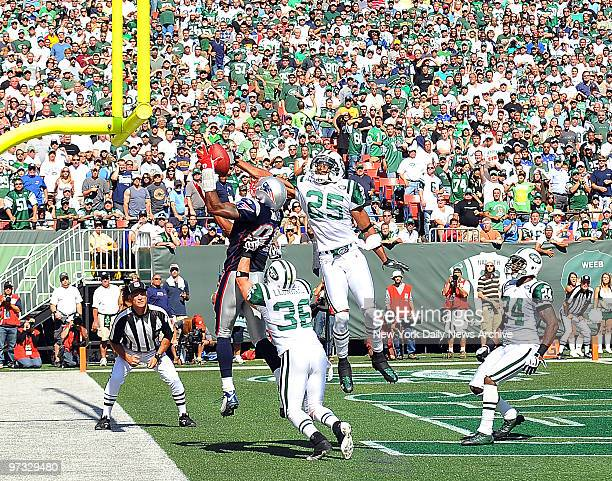 Kerry Rhodes does part to break up pass to New England Patriots wide receiver Randy Moss in end zone in waning seconds of first half as Jets safety...