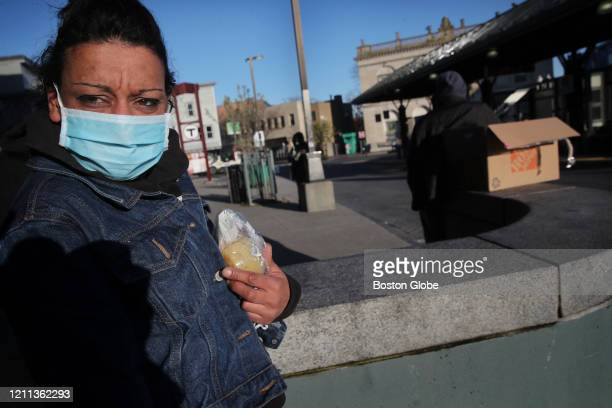 Kerry Seerattan appreciated the new face mask she received while passing through Nubian Station in the Roxbury neighborhood of Boston, MA on April...