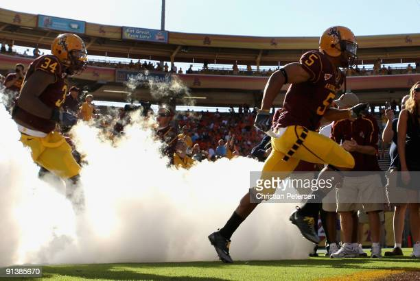 Kerry Taylor and James Brooks of the Arizona State Sun Devils runs out onto the field before the college football game against the Oregon State...