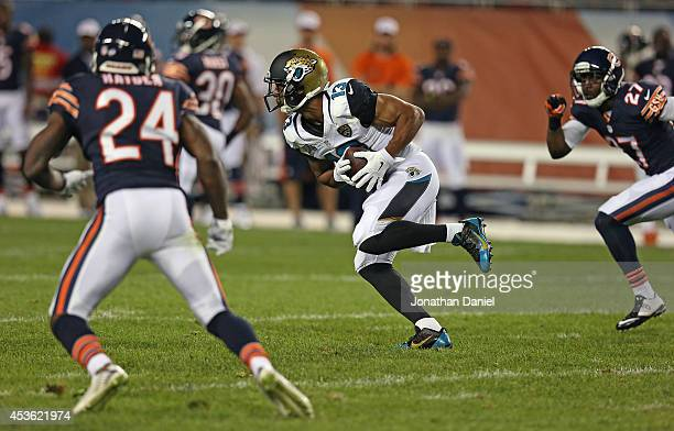 Kerry Taylor of the Jacksonville Jaguars catches a pass between Kelvin Hayden and Sherrick McManis of the Chicago Bears during the second quarter of...