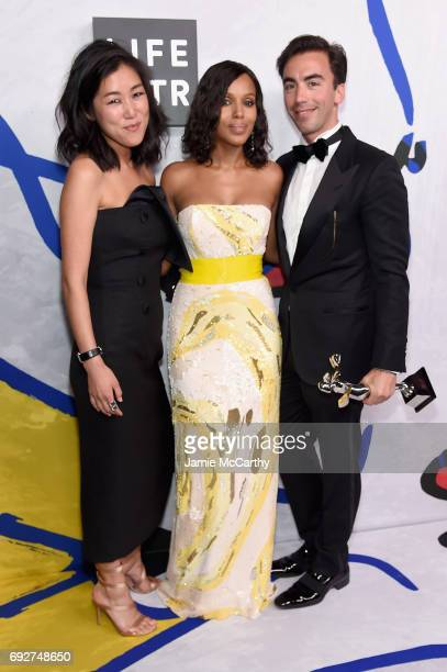 Kerry Washington poses with designers Laura Kim and Fernando Garcia for Monse winners of the Swarovski Award for Emerging Talent on the Winners Walk...
