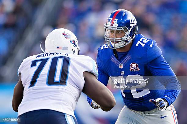 Kerry Wynn of the New York Giants is blocked by Chance Warmack of the Tennessee Titans at LP Field on December 7 2014 in Nashville Tennessee The...