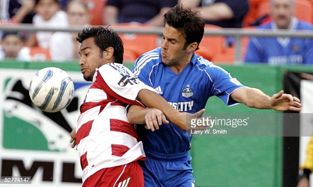 Kerry Zavagnin of the Kansas City Wizards goes for a ball against Carlos Ruiz of FC Dallas during the first half on May 7 2005 at Arrowhead Stadium...