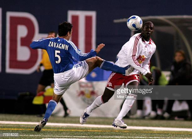 Kerry Zavagnin of the Kansas City Wizards kicks Jozy Altidore of the New York Red Bulls in an attempt to steal the ball at Giants Stadium in the...