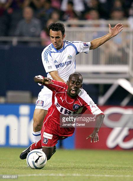 Kerry Zavagnin of the Kansas City Wizards knocks down Thiago of the Chicago Fire on August 10 2005 at Soldier Field in Chicago Illinois The Wizards...