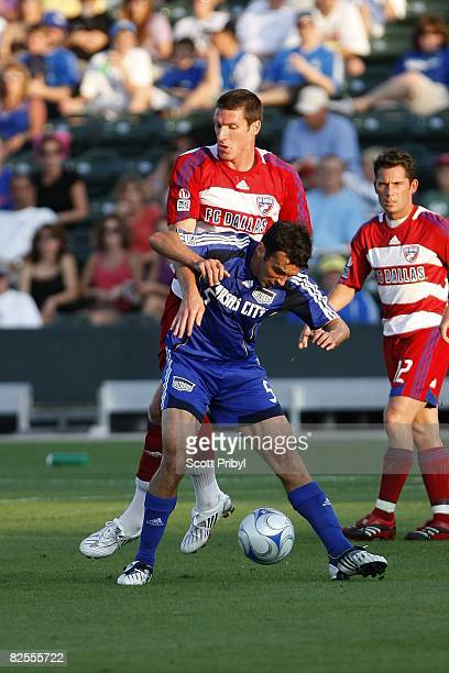 Kerry Zavagnin of the Kansas City Wizards protects the ball from Kenny Cooper of FC Dallas during the game at Community America Ballpark on August 23...