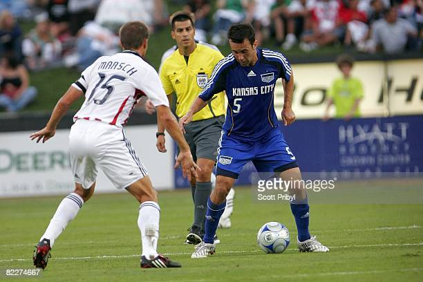 Kerry Zavagnin of the Kansas City Wizards tries to get past Jesse Marsch of Chivas USA during the game at Community America Ballpark on August 9 2008...