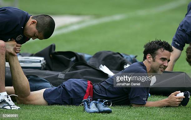 Kerry Zavagnin of the United States National Team gets his foot massaged by a trainer during a training session on May 23 2005 at Dominican...