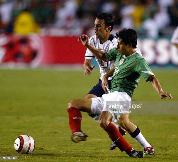 Kerry Zavagnin of the USA national team moves the ball past Ricardo Osario of Mexico during an International Friendly on April 28 2004 at the Cotton...