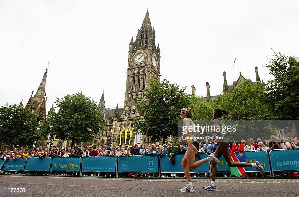 Kerryn McCann of Australia leads Esther Maina Wanjiru of Kenya during the Womens Marathon in front of the town hall in Manchester England on July 28...