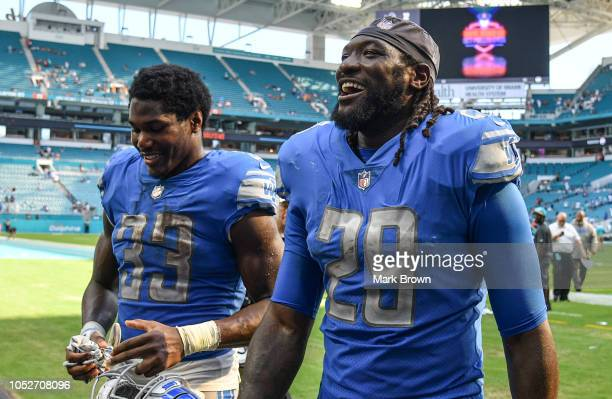Kerryon Johnson and LeGarrette Blount of the Detroit Lions head to the locker room after the game against Miami Dolphins at Hard Rock Stadium on...