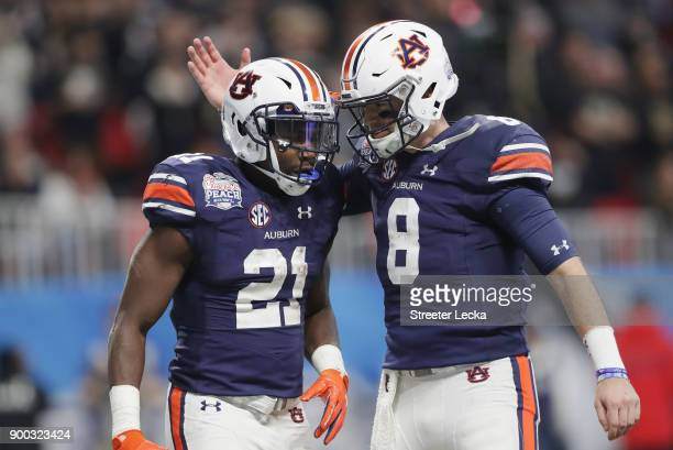 Kerryon Johnson of the Auburn Tigers celebrates with Jarrett Stidham after scoring a touchdown in the third quarter against the UCF Knights during...