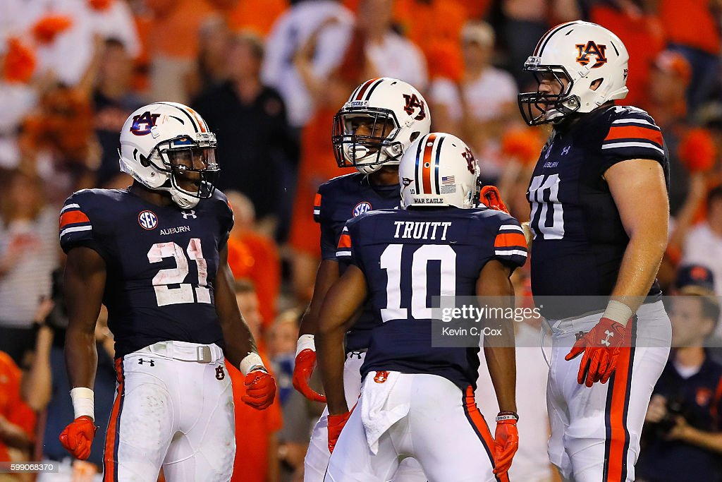 Kerryon Johnson #21 of the Auburn Tigers (L) celebrates with teammates after scoring a touchdown during the fourth quarter against the Clemson Tigers at Jordan Hare Stadium on September 3, 2016 in Auburn, Alabama.