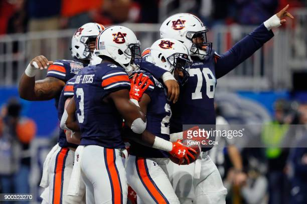 Kerryon Johnson of the Auburn Tigers celebrates with teammates after scoring a touchdown in the third quarter against the UCF Knights during the...