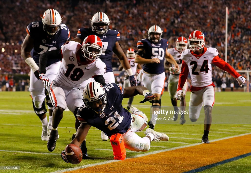 Kerryon Johnson #21 of the Auburn Tigers dives for a touchdown past Deandre Baker #18 of the Georgia Bulldogs at Jordan Hare Stadium on November 11, 2017 in Auburn, Alabama.
