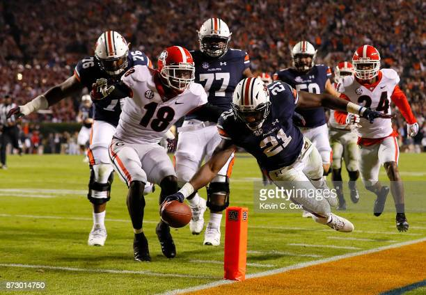 Kerryon Johnson of the Auburn Tigers dives for a touchdown past Deandre Baker of the Georgia Bulldogs at Jordan Hare Stadium on November 11 2017 in...