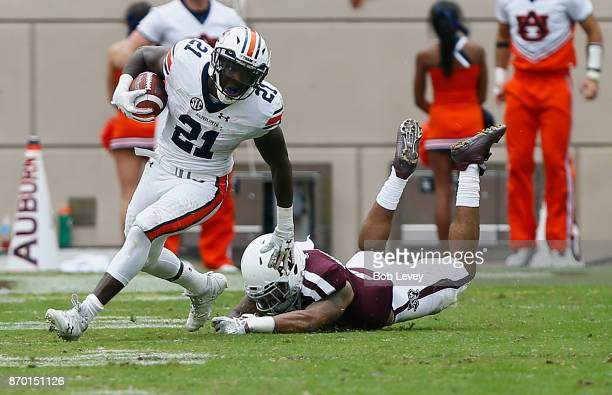 Kerryon Johnson of the Auburn Tigers fends off Larry Pryor of the Texas AM Aggies at Kyle Field on November 4 2017 in College Station Texas