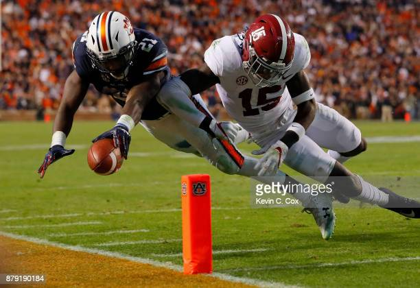 Kerryon Johnson of the Auburn Tigers is hit by Ronnie Harrison of the Alabama Crimson Tide diving towards the endzone during the third quarter of...