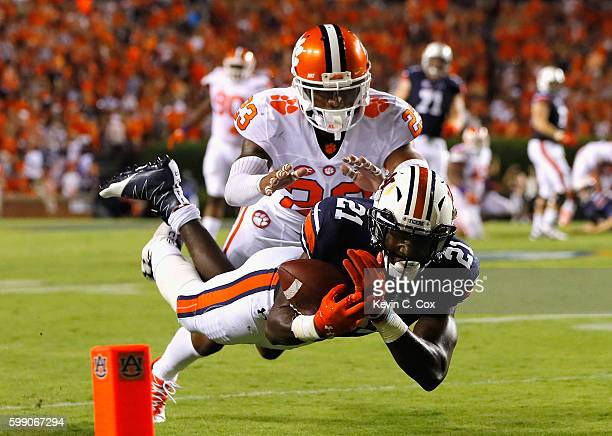 Kerryon Johnson of the Auburn Tigers is unable to make the catch against Van Smith of the Clemson Tigers during the second half at Jordan Hare...