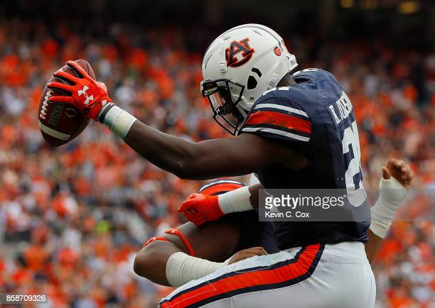Kerryon Johnson of the Auburn Tigers reacts after scoring a touchdown against the Mississippi Rebels with Darius James at Jordan Hare Stadium on...