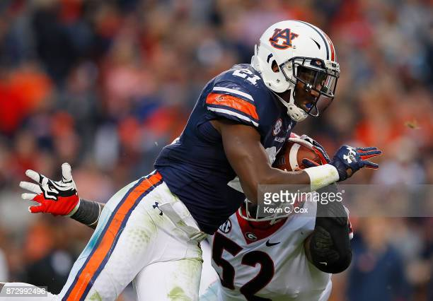 Kerryon Johnson of the Auburn Tigers rushes against Tyler Clark of the Georgia Bulldogs at Jordan Hare Stadium on November 11 2017 in Auburn Alabama