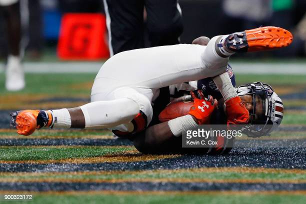 Kerryon Johnson of the Auburn Tigers scores a touchdown in the third quarter against the UCF Knights during the ChickfilA Peach Bowl at MercedesBenz...