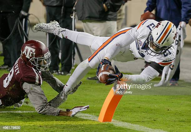 Kerryon Johnson of the Auburn Tigers steps out of bounds before crossing ther goal line as Nick Harvey of the Texas AM Aggies pushes him out in the...