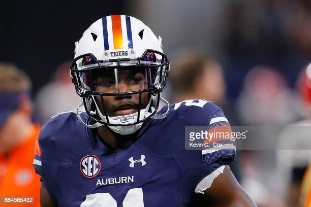 Kerryon Johnson of the Auburn Tigers warms up prior to the game against the Georgia Bulldogs in the SEC Championship at MercedesBenz Stadium on...
