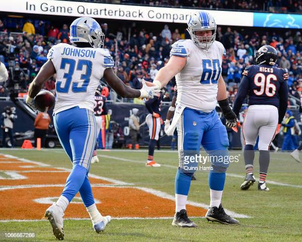 Kerryon Johnson of the Detroit Lions and Graham Glasgow of the Detroit Lions shake hands after scoring against the Chicago Bears at Soldier Field on...