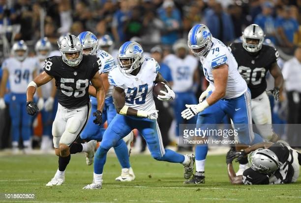 Kerryon Johnson of the Detroit Lions carries the ball against the Oakland Raiders during the third quarter of an NFL preseason football game at...