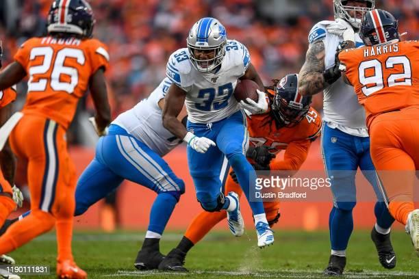 Kerryon Johnson of the Detroit Lions carries the ball in the third quarter of a game against the Denver Broncos at Empower Field on December 22 2019...
