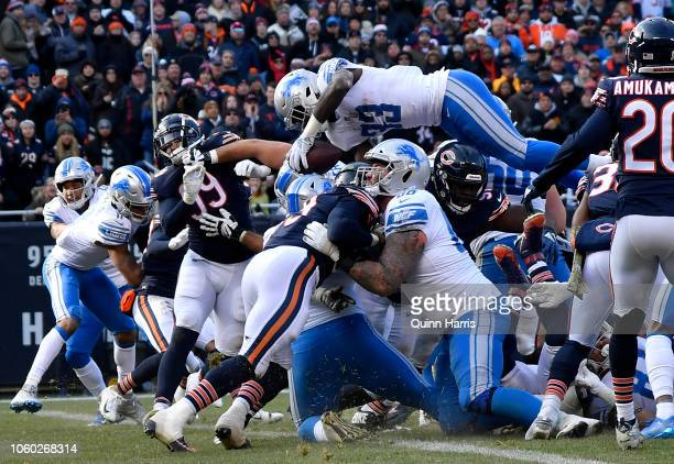 Kerryon Johnson of the Detroit Lions jumps into the endzone for a touchdown in the second quarter against the Chicago Bears at Soldier Field on...