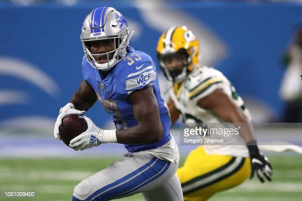 Kerryon Johnson of the Detroit Lions looks for yards after a catch against the Green Bay Packers at Ford Field on October 7 2018 in Detroit Michigan