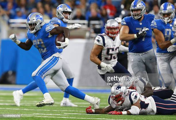 Kerryon Johnson of the Detroit Lions runs against the New England Patriots during the second half at Ford Field on September 23 2018 in Detroit...