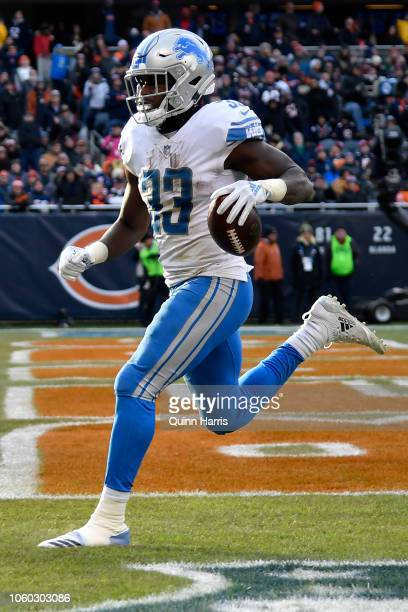Kerryon Johnson of the Detroit Lions runs the football into the endzone against the Chicago Bears in the fourth quarter at Soldier Field on November...