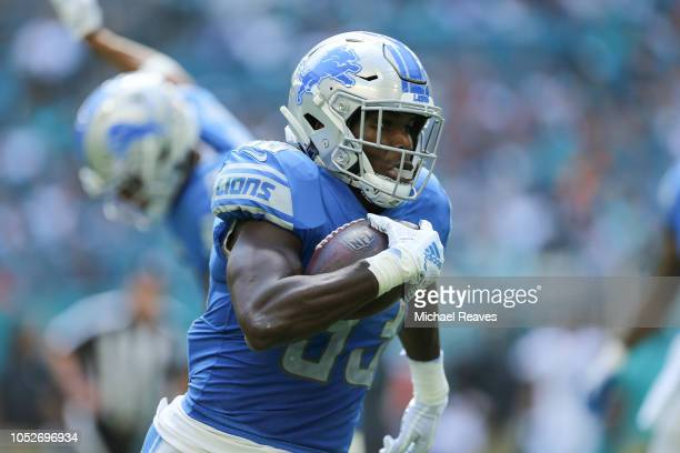 Kerryon Johnson of the Detroit Lions runs with the ball against the Miami Dolphins during the first half at Hard Rock Stadium on October 21 2018 in...