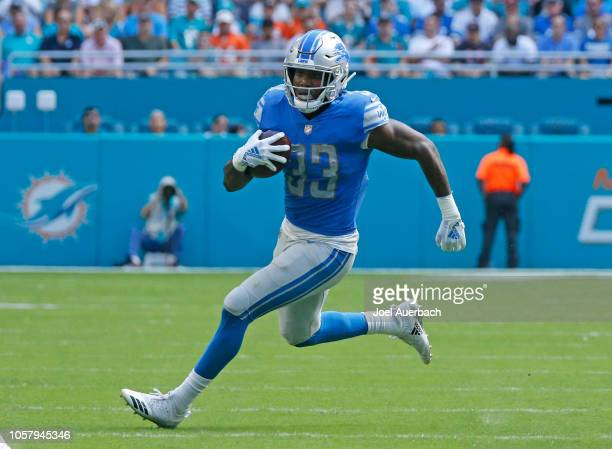 Kerryon Johnson of the Detroit Lions runs with the ball against the Miami Dolphins during an NFL game on October 21 2018 at Hard Rock Stadium in...