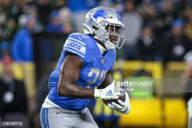 Kerryon Johnson of the Detroit Lions runs with the ball in the second quarter against the Green Bay Packers at Lambeau Field on October 14 2019 in...