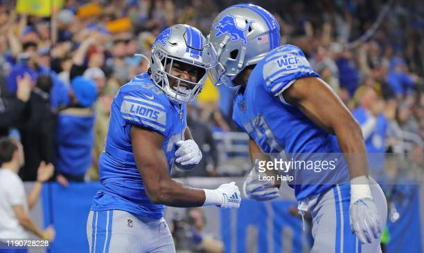 Kerryon Johnson of the Detroit Lions scores a touchdown and celebrates with teammate Jason Cabinda during the second quarter of the game against the...