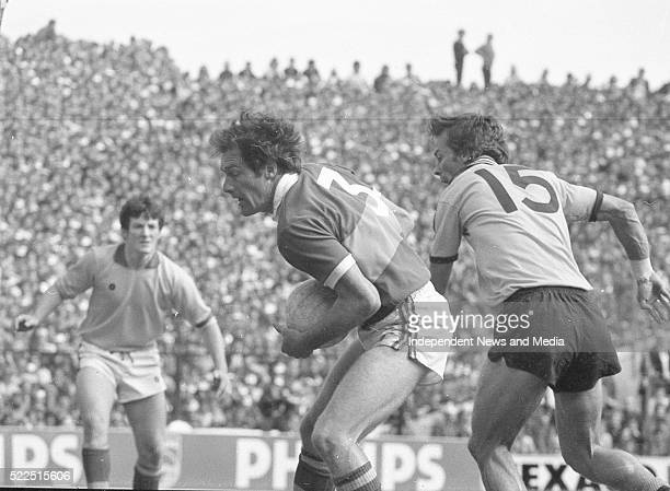 Kerry's John O'Keefe being tackle by Dublin's John McCarthy as Kerry goalkeeper Charlie Nelligan awaits the outcome, Dublin v Kerry All-Ireland final...