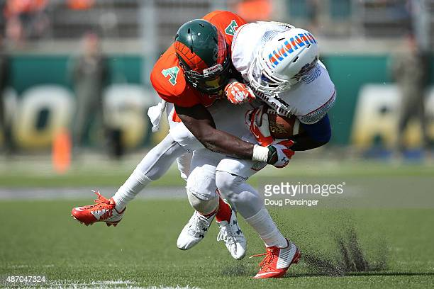 KerSean Wilson of the Savannah State Tigers makes a pass reception and is tackled by Kevin PierreLouis of the Colorado State Rams at Sonny Lubick...