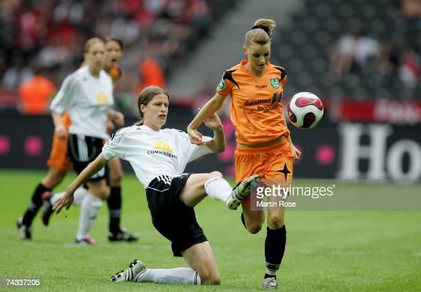 Kerstin Garefekes of Frankfurt and Corinna Schroeder of Diusburg vie for the ball during the Women's DFB German Cup final between 1FFC Frankfurt and...