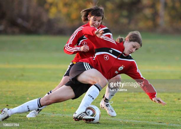 Kerstin Garefrekes and Ariane Hingst fight for the ball during the Women's Training Session at WSV Wendschott Stadium on October 25 2010 in Wolfsburg...