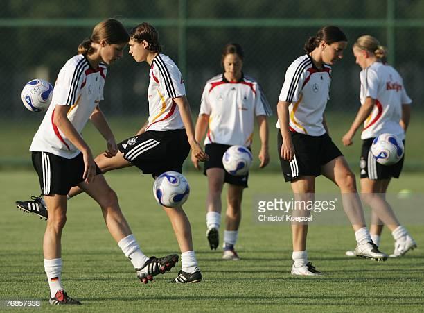 Kerstin Garefrekes, Annike Krahn, Renate Lingor, Birgit Prinz and Simone Laudehr juggle with the ball during the Women's German National Team...
